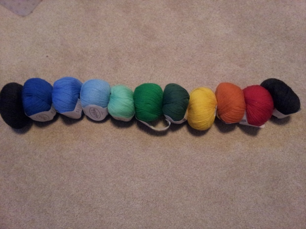 All the yarn I selected for my temperature scarf laid out in order (except Delta - the darkest blue).