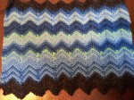 The temperature scarf for the month of January with a sc ripple stitch.